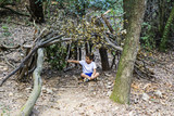 Little boy in his homemade cabin on the woods - 226244207