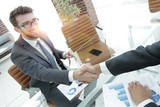 handshake business partners at your Desk - 226256658