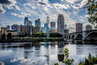 Daytime Cityscape skyline of Downtown Minneapolis Minnesota in the Twin Cities Metro area. Reflection in the Mississippi River