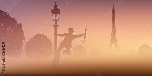Un homme danse avec un parapluie, autour d'un lampadaire, devant la tour Eiffel à Paris. - 226264291