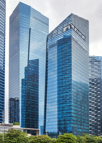Glass high skyscrapers in the center of Singapore on the waterfront.