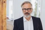 Elegant mature bearded man with glasses - 226301809