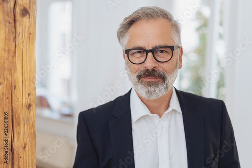 Leinwandbild Motiv Elegant mature bearded man with glasses