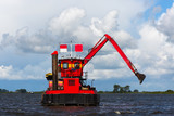 Dredger working on  the lake. - 226303886