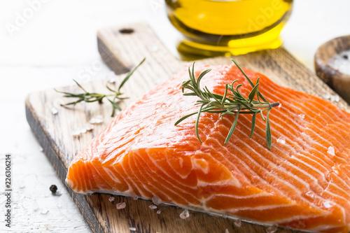 Leinwanddruck Bild Uncooked salmon fillet with lemon sea salt and rosemary on white