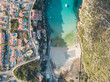 Aerial bird's eye view drone of boat docked in mediterranean tropical beach with turquoise - sapphire waters - 226310690