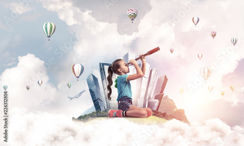 Foto Murales Concept of careless happy childhood with girl looking in future