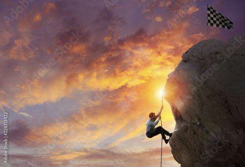 Leinwanddruck Bild Businessman try to reach the goal. Difficult career concept