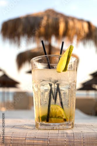 Exotic summer drinks , blur sandy beach on background - 226316208