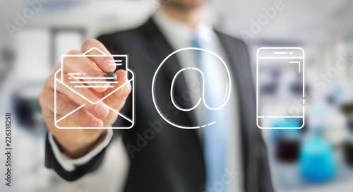 Leinwanddruck Bild Businessman drawing thin line contact icon