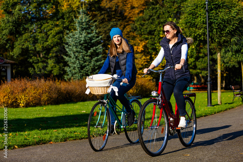 Healthy lifestyle - people riding bicycles in city park - 226320061