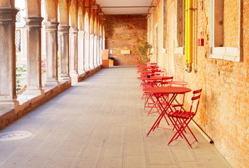 street with cafe tables in Venice, Italy
