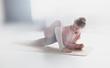 Leinwandbild Motiv Young woman doing yoga exercise