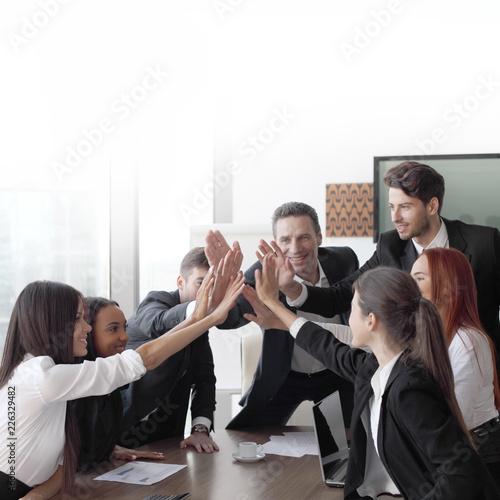 Fridge magnet Business team making high five