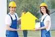 Workers with house model symbol - 226330619