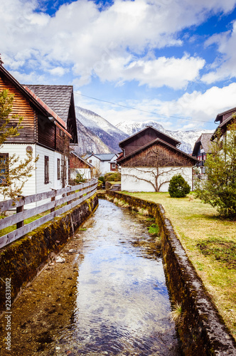 Small mountain river in the village in Austria - 226331012