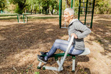 Healthy Mature Woman Practicing At Outdoor Gym