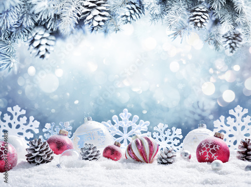 Leinwanddruck Bild Christmas Card - Baubles On Snow With Snowy Fir Branches