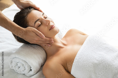 Young and beautiful woman during facial massage session © blackday