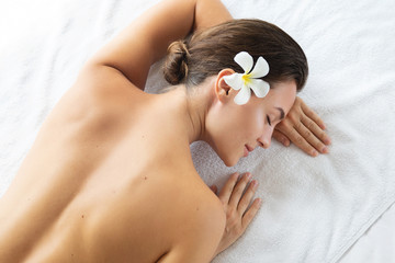 Woman is lying and relaxing after massage session © blackday