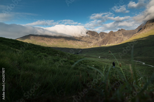 clouds floating over a mountain - 226371877