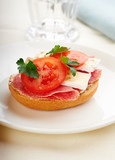 Sandwich with salami, cream cheese, tomatoes, camembert and fresh parsley served on a plate. Home made food Symbolic image Concept for a tasty and healthy meal. White background  - 226374856
