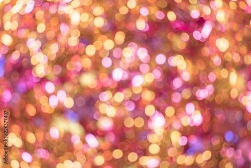 Background texture full of unsharp golden and pink shining bokeh