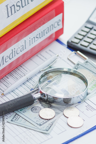 Clean insurance form, loupe, calculator, pen and money - 226404835