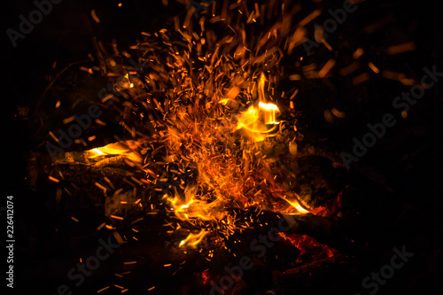 Beautiful bonfire with sparks flying upwards, view from above - 226412074