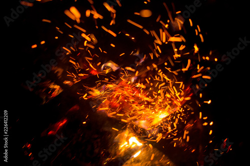 Beautiful bonfire with sparks flying upwards, view from above - 226412209