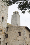 Medieval buildings, tower and stone walls in San Gimignano, Tuscany, Italy