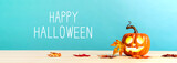 Happy Halloween message with pumpkin with leaves on a blue background - 226425029