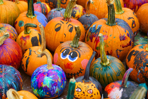 Leinwanddruck Bild group of colorful painted pumpkin for Halloween in autumn