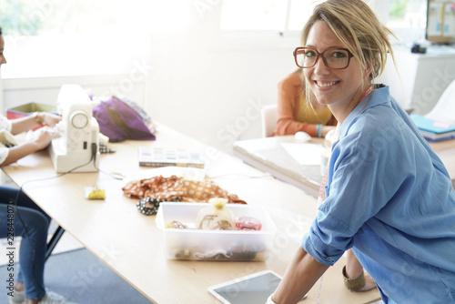 Portrait of smiling fashion designer in workshop