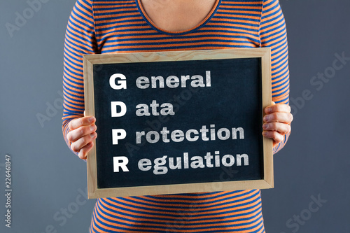Female hands holding small black chalkboard with General Data Protection Regulation text