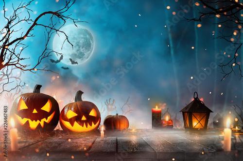 Leinwandbild Motiv Halloween pumpkins on dark spooky forest.