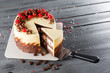 Tasty cake with chocolate and cherries in wooden background