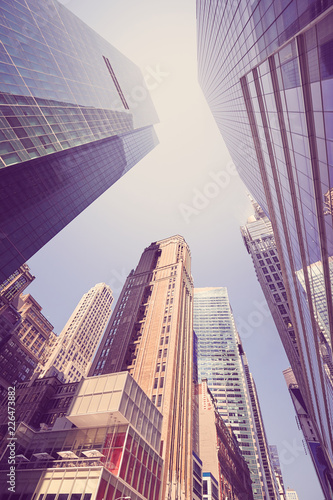 New York City skyscrapers, looking up perspective, color toned picture, USA.