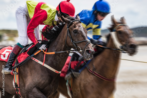 Close-up on jockey and race horse galloping at speed, motion blur zoom effect © gabe9000c