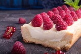 Tarte shortcake with mascarpone, white chocolate and cream served with fresh raspberries and red currant.