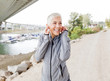 Happy Mature Woman Relax Listening Music With Earphones After Jogging