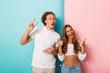 Leinwandbild Motiv Cheerful young couple isolated