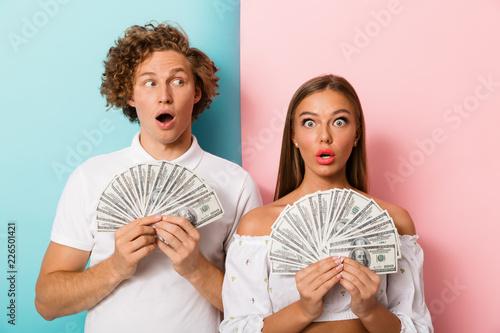 Leinwanddruck Bild Surprised young couple standing
