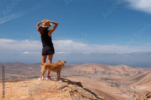 girl watching the panorama with her puppy dog
