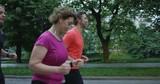 Joggers running at morning in city park - 226536258