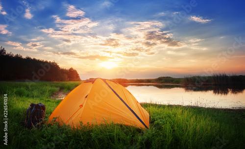 Foto Murales Orange tourist tent by the lake
