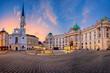 Leinwandbild Motiv Vienna, Austria. Cityscape image of Vienna, Austria with St. Michael's Church and located at St. Michael Square during sunrise.
