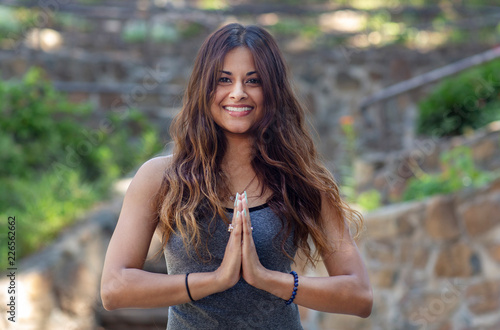 Sticker Beautiful Smiling Female Yoga Instructor with Hand in Prayer Position