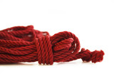 One skein of jute rope six millimeters for Japanese bondage and shibari, painted in red on a white background. Professionally knitted hank