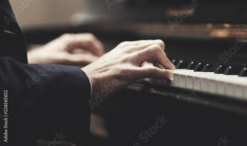 Close up of a musician playing a piano keyboard - 226565652